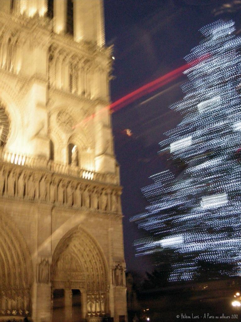 Notre Dame de Paris and its Christmas tree by parisouailleurs