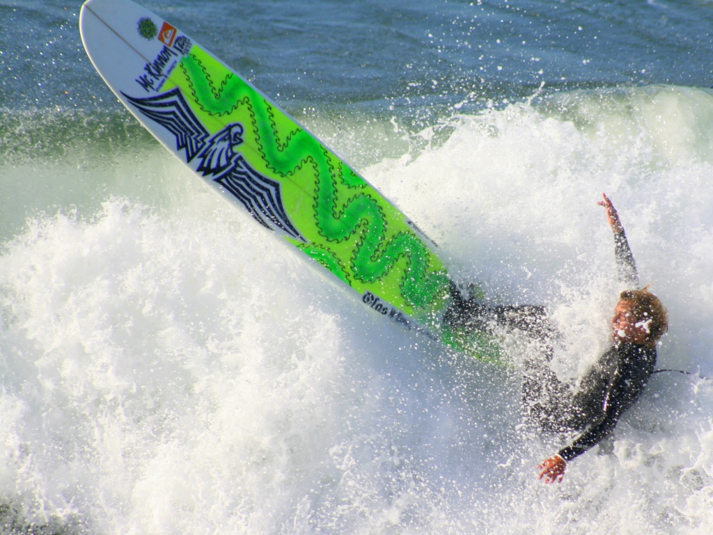 Surfing At Huntington Beach by kerristephens