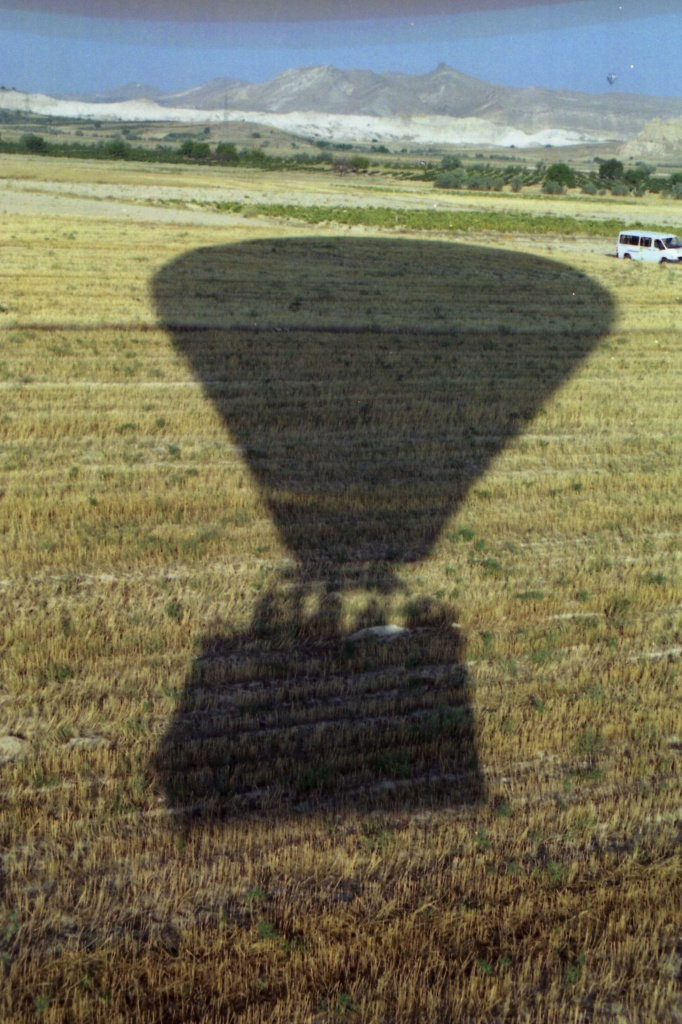 film Feb - hot air balloon coming in for a landing - one of the shadows is me by lbmcshutter