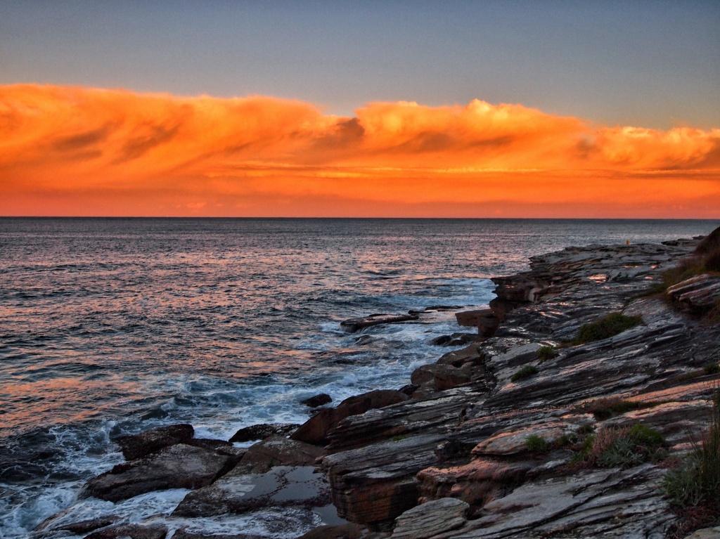 Clouds of orange sherbet by peterdegraaff