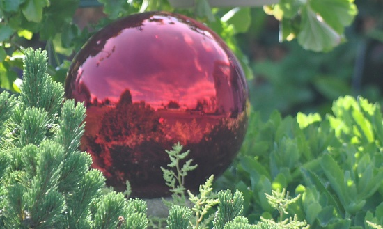 Red globe reflection. by sailingmusic