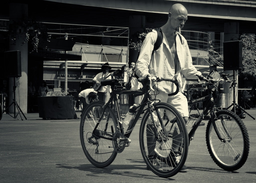 Man with Two Bikes by northy