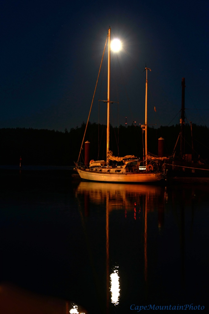 Sailboat Resting in the Moonlight by jgpittenger