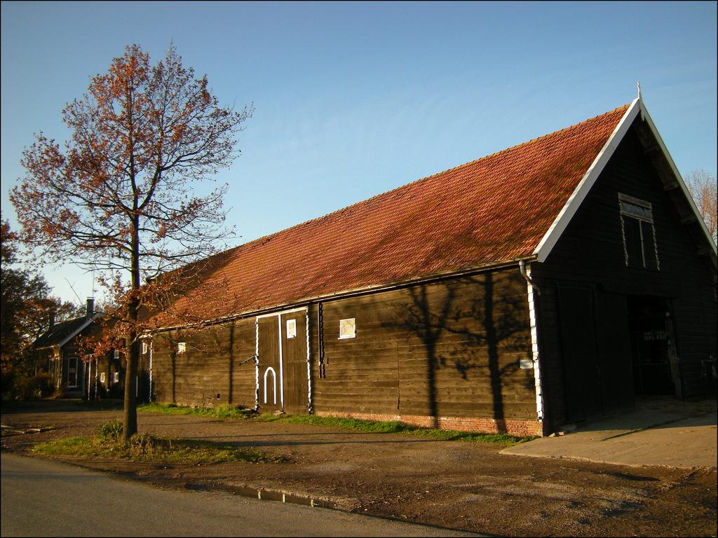 An old farmhouse with barn by pyrrhula
