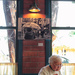 A Customer At Fins Bistro Sitting Under One Of My Photographs On Display! by seattle