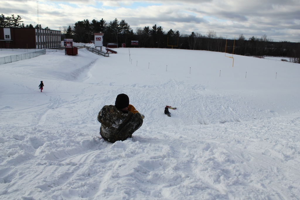 Big kid and little kids sledding by mandyj92