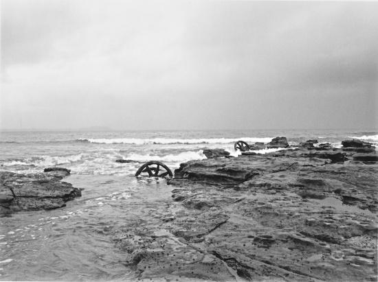 Old tram wheels in the tide by peterdegraaff