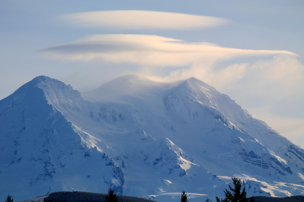 Lenticular clouds over Mt Rainier. by jankoos