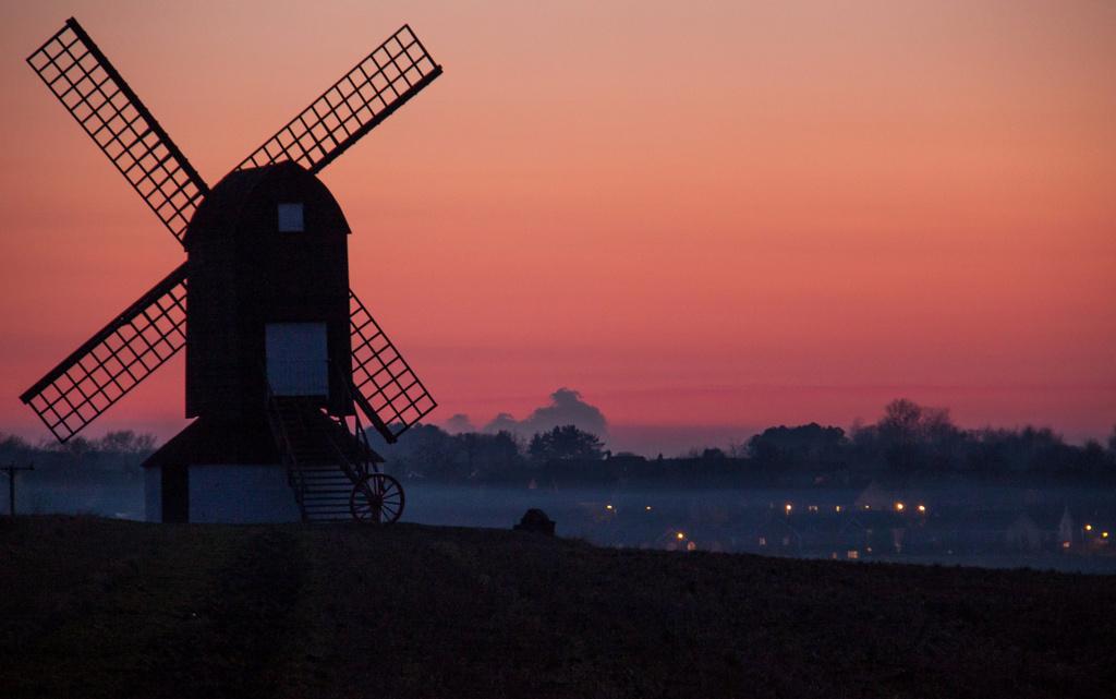 Windmill and misty sunset by dulciknit