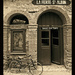 Old railway station waiting room and bicycle, La Ferte St Aubin, France by ivan