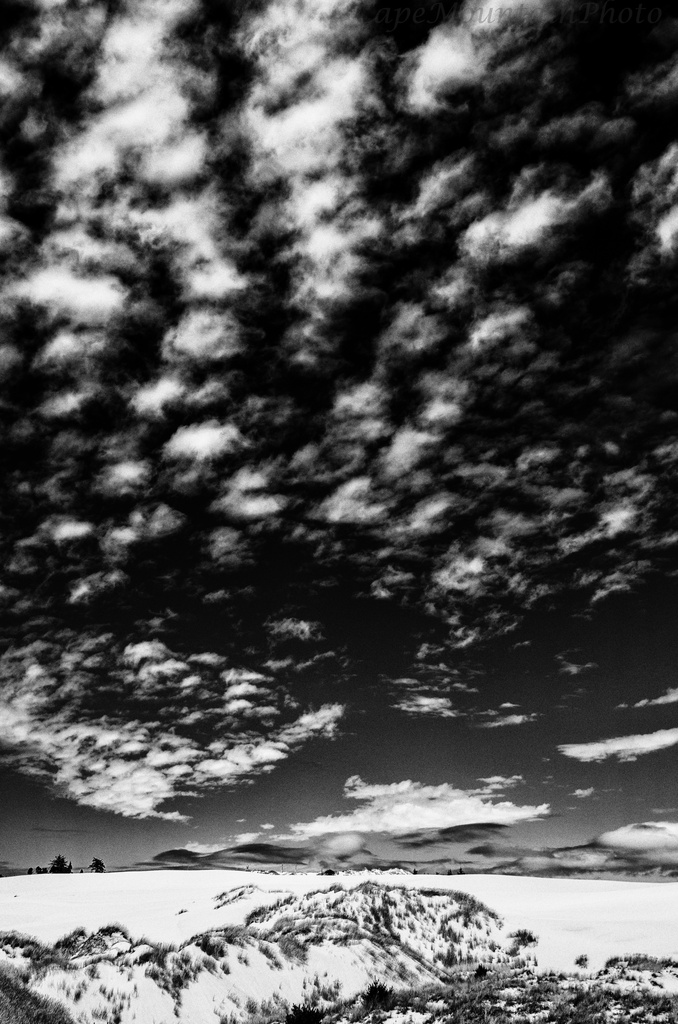 Black and White Clouds Over the Dunes by jgpittenger