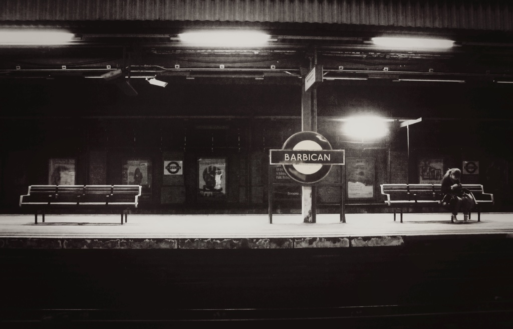 Lone figure... Waiting on the train that never comes... by streats