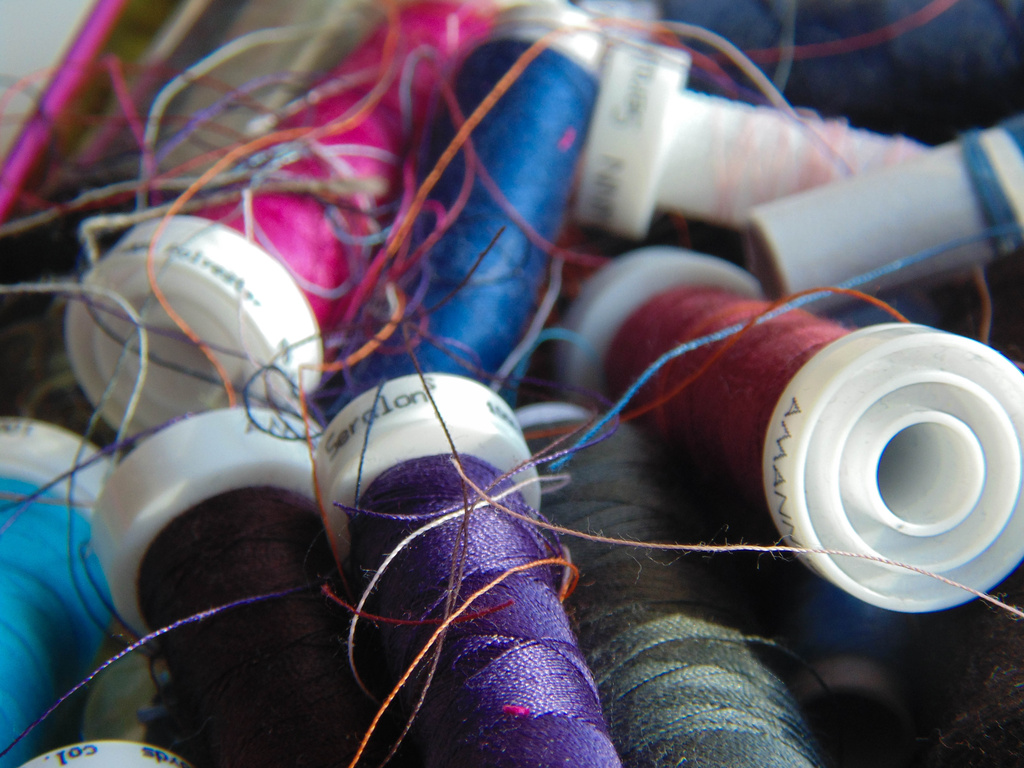 Coloured mess inside the yarn box by justaspark
