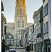 Cyclist with church of St Gummarus, Lier, Belgium by ivan