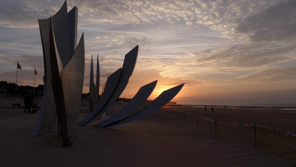 Sunset on Omaha Beach by judithdeacon