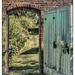 Doorway through garden wall by ivan