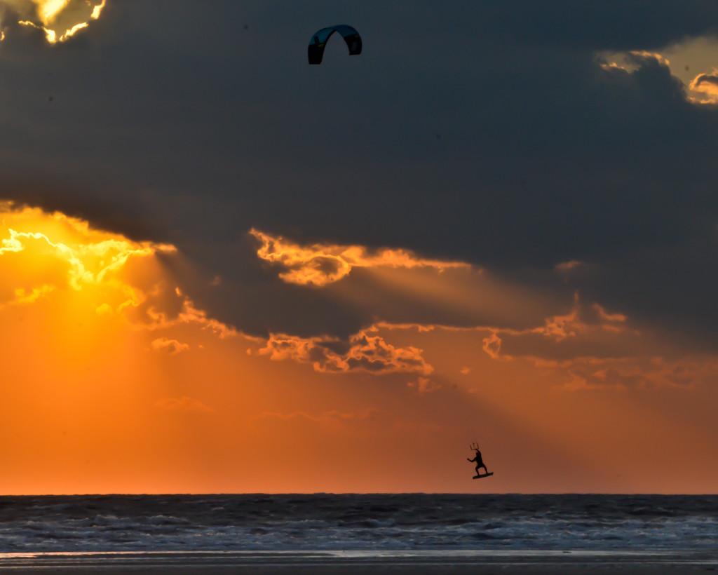 Kiteboarder at sunset by mccarth1