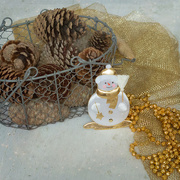 17th Dec 2014 - Still life with pine cones, snowman and gold.