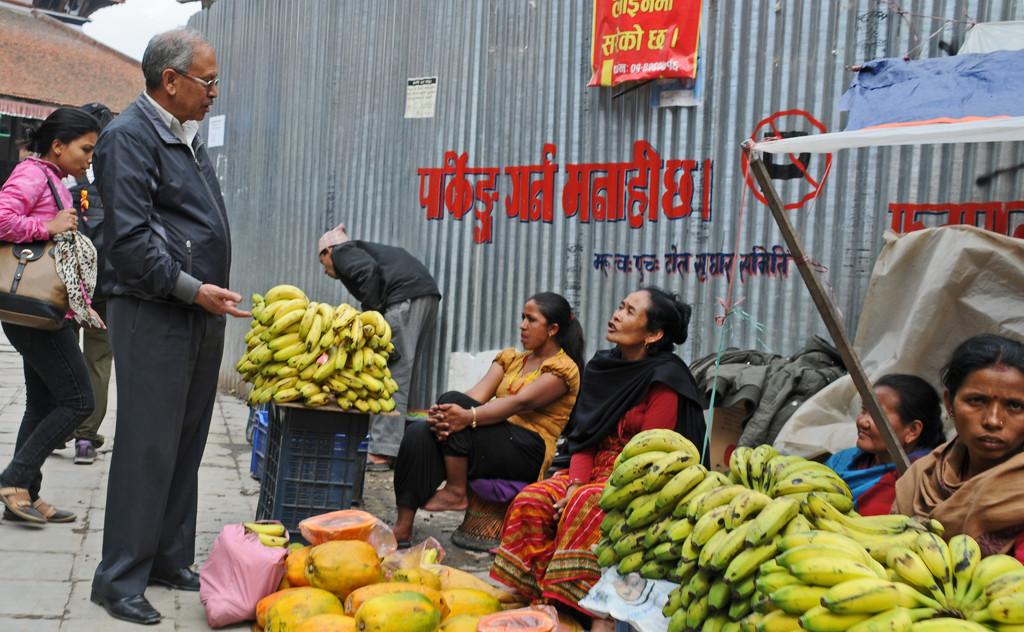 Bartering for Pumkin Nepalese street seller by ianjb21