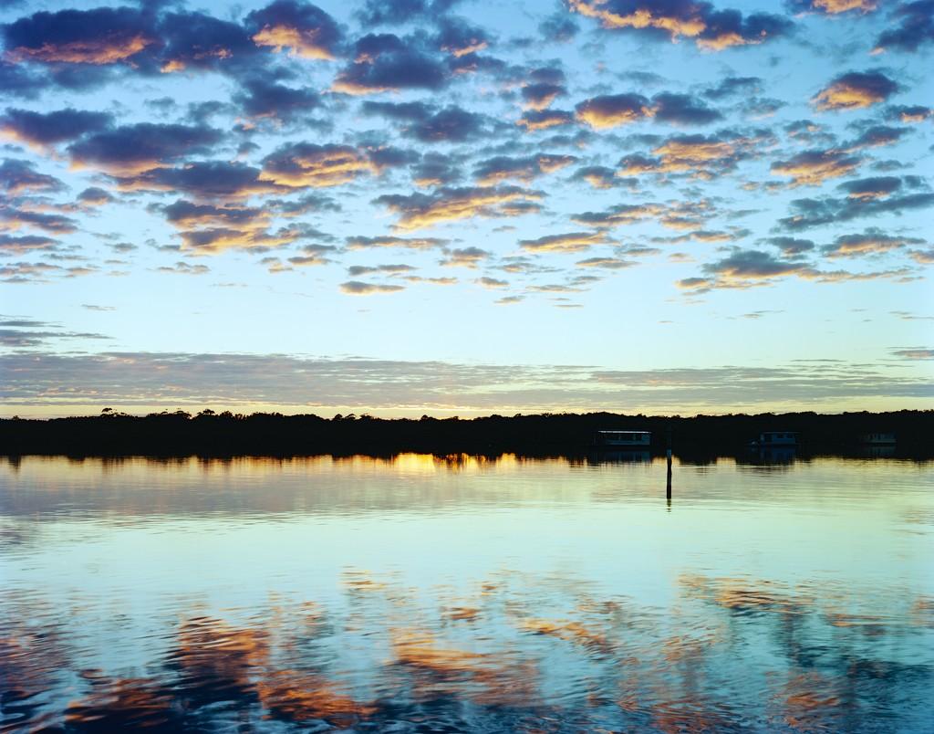 Early lit clouds by peterdegraaff