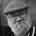 50 mono portraits at 50mm : No. 34 : Flat Cap, Glasses and Beard by phil_howcroft