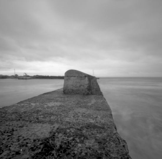 Rounded harbour wall by peterdegraaff