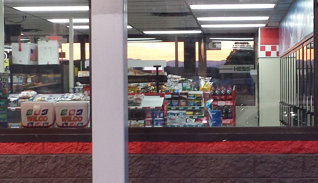 Sunset through the gas station window by randystreat