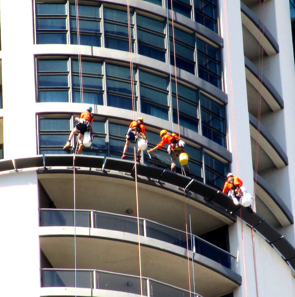 The Gangs out today-Washing windows 15 stories up. by 777margo