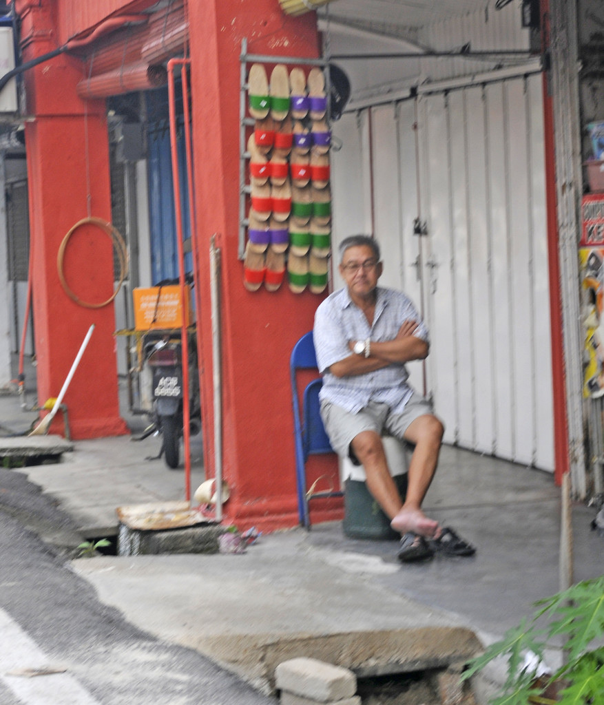 Shoe trader taking a rest by ianjb21