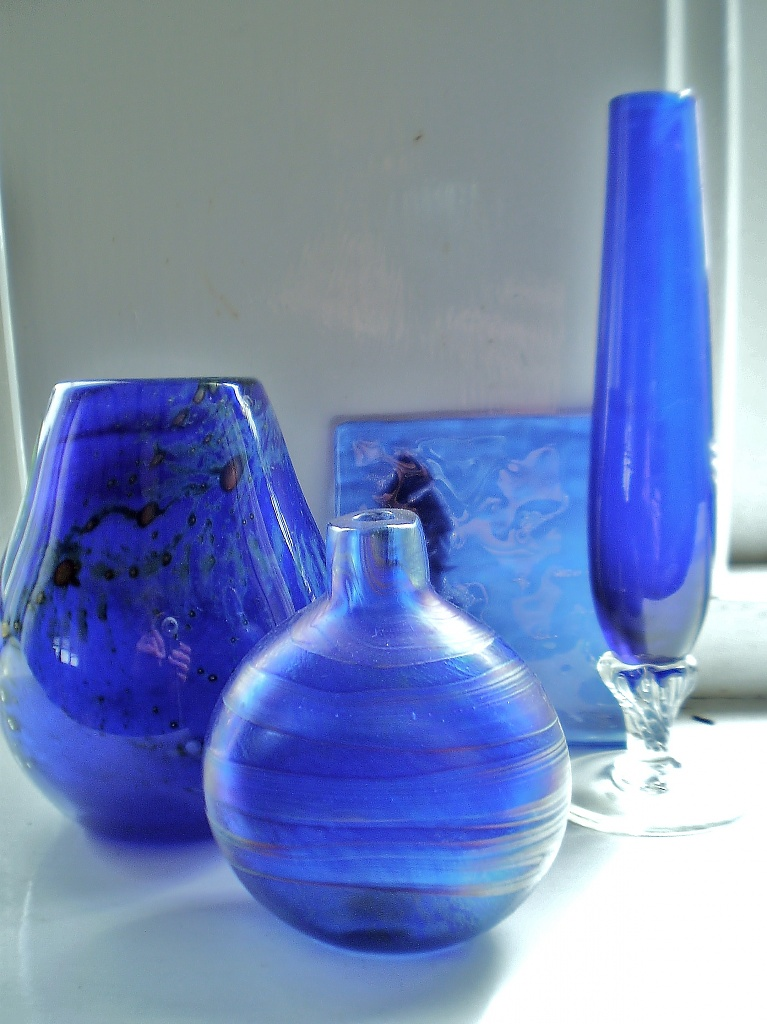 Collection of blue glass by snowy