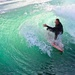 Surfer inside the wave curl:  tighter crop by jyokota