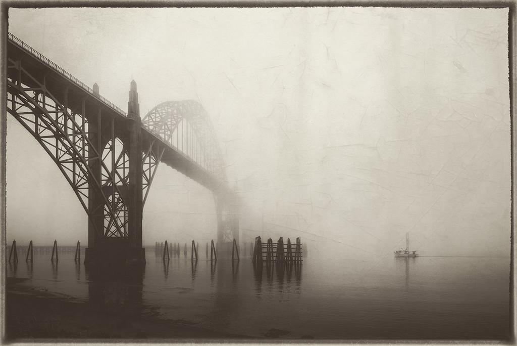 Boat Going Under Bridge In Fog  by jgpittenger