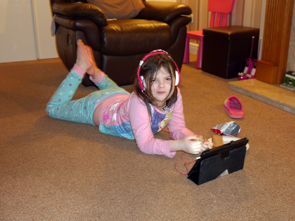Maddi, the Kindle and her Headphones..... by brickmaker