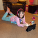 Maddi, the Kindle and her Headphones.....