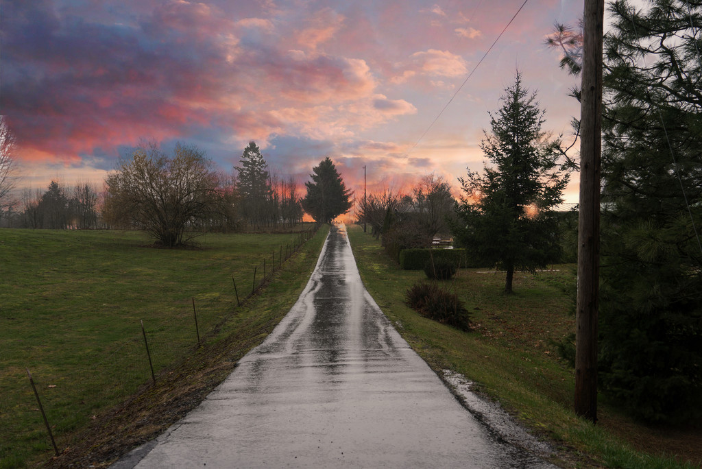Wet road and sunset by teiko