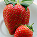 Large and small strawberries by elisasaeter
