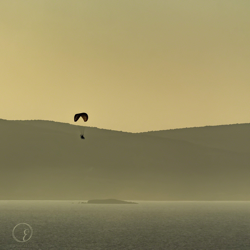 Ultralight with St George's Island in the background by evalieutionspics