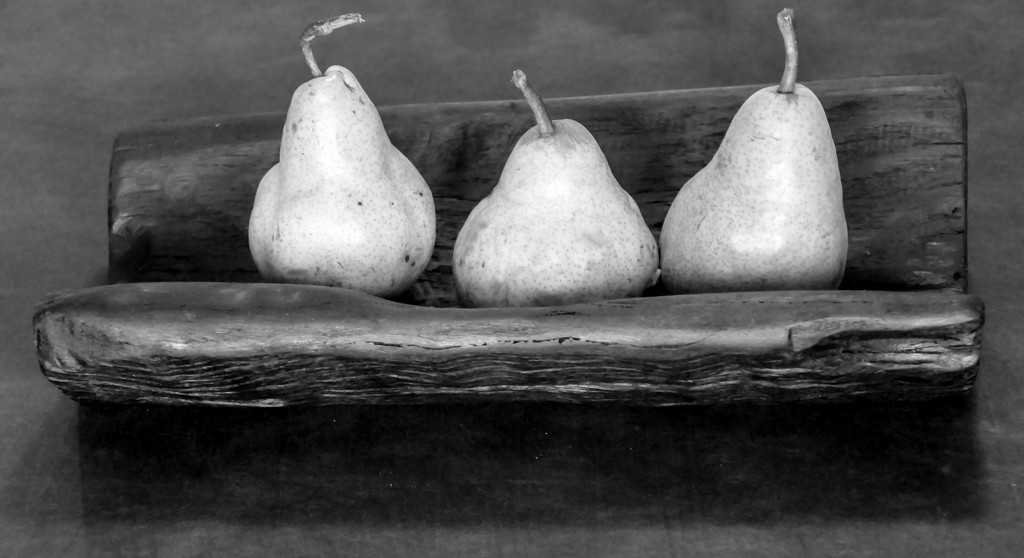 Three pears leaning by hrs