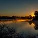 Light spills onto Lake Estes by joansmor