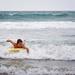 Reuben paddling for a wave