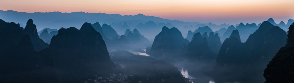 Sunrise Over Yangshuo Karst Formations by taffy