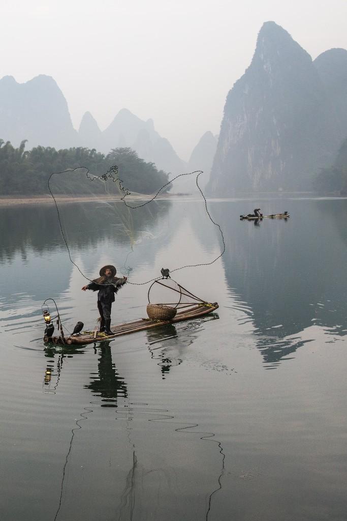 Cormorant Fisherman Casting Net by jyokota