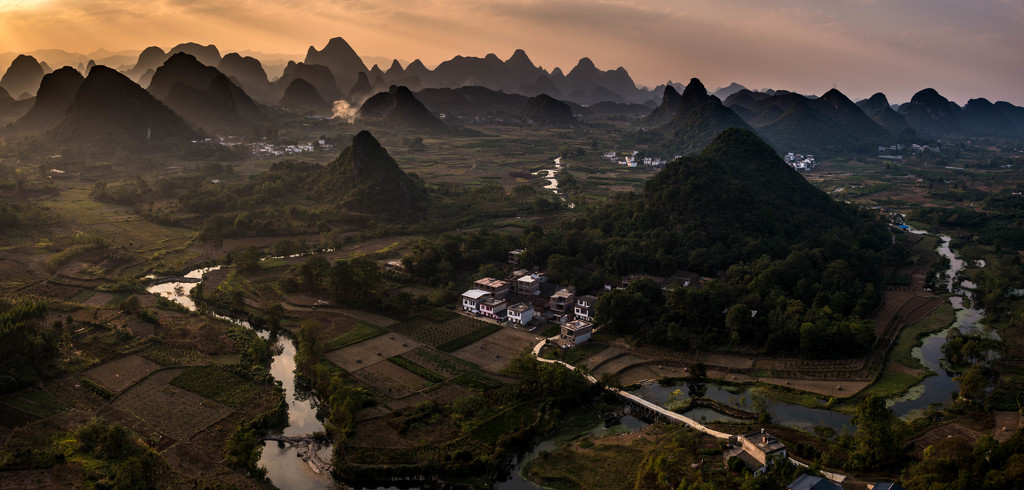 Sunset Over the Karst Formations and River by taffy