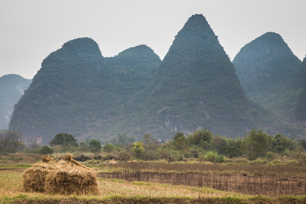 Haystacks Against the Guilin Mountains by jyokota