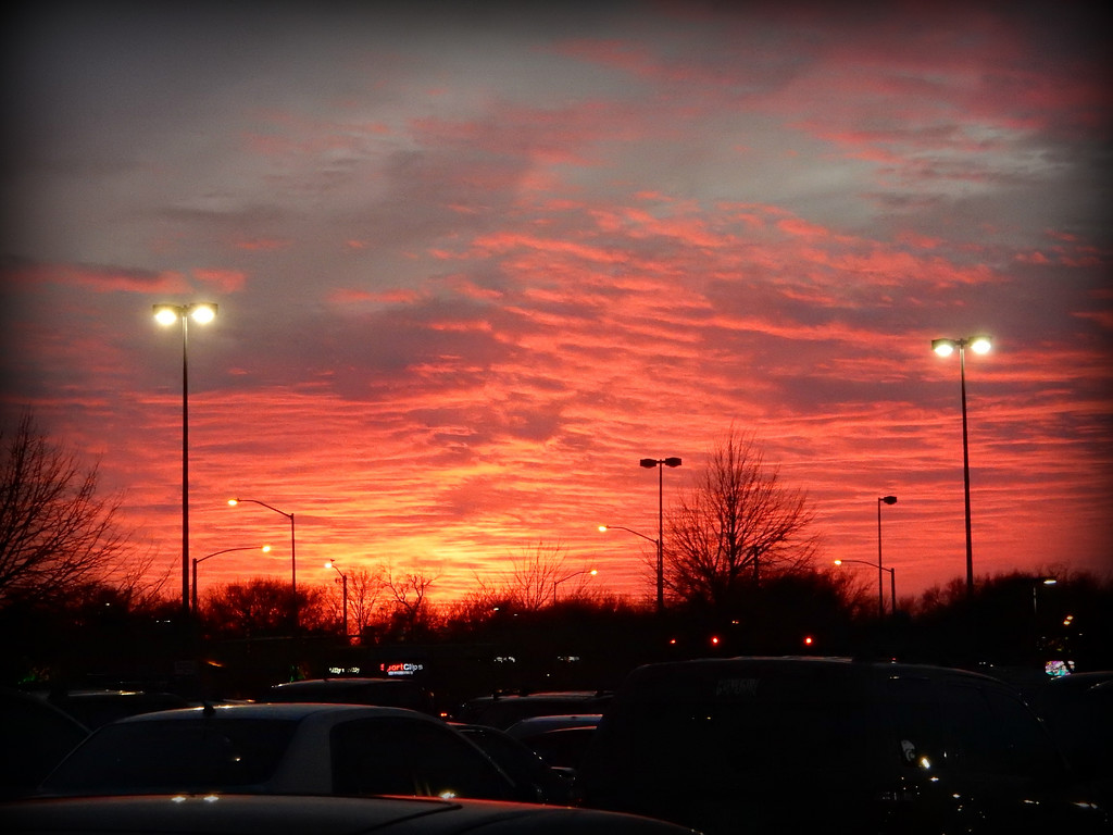 Sunset over Walmart parking lot by mcsiegle