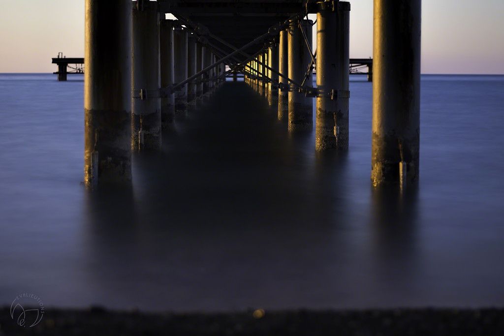 Under the Pier at Sunset by evalieutionspics