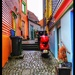 Colourful alleyway in Stavanger - love the red scooter too! by lyndamcg