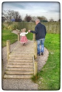 28th Mar 2017 - My hubby walking granddaughter Abigail over the bridge in the play area on Sunday