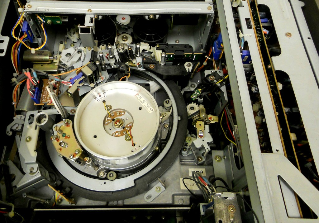 The innards of an old tape deck by mittens