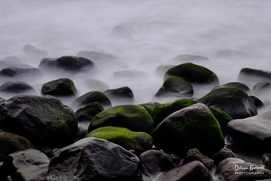 Rocks in the surf by dkbarnett